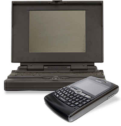 Image of an old computer and blackberry